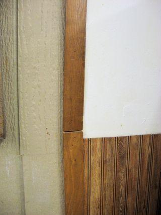 24 - Trim, bead board, siding west wall
