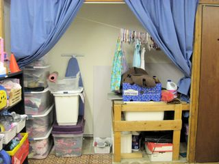 16 - Storage behind curtains
